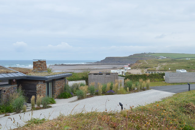 View across to the beach with chalets dotted about.