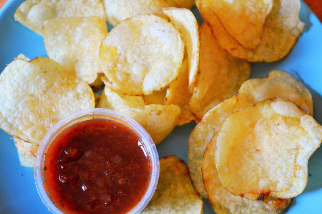Crisps on a blue plate with dip.