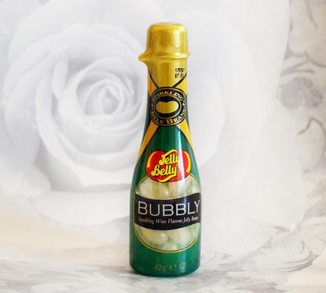 A green bottle iwth jelly belly sweets inside.