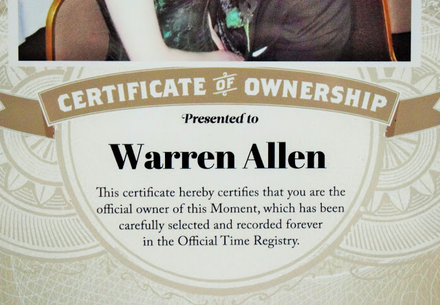 A close up picture of the certificate saying that it certifies that Warren Allen owns this particular moment.