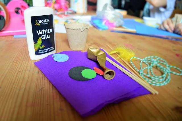 Glue, tissue paper, balloon, skewers.