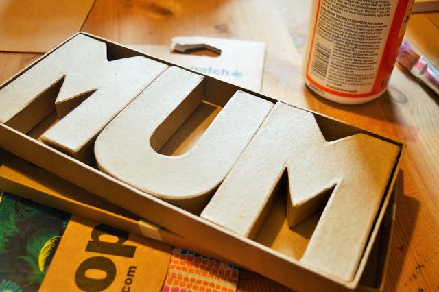 A box with mache MUM inside.