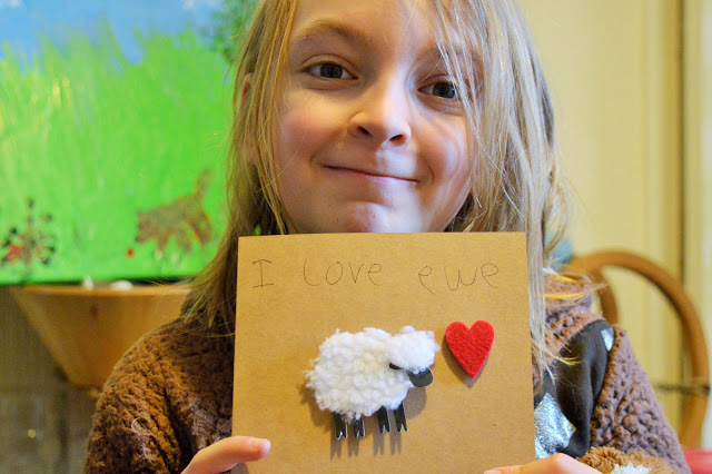 George holding the finished card with 'I Love Ewe' on it.