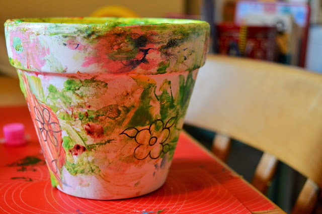Plant pot painted in a mixture of colours.