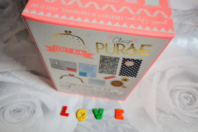 A box with a make-your-own purse inside with love spelt out in letters below it.