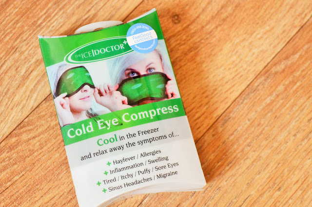 Green and white package with eye mask inside.