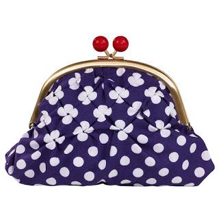 A blue and white polka dot clasp purse.