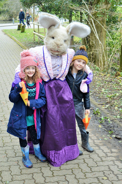 George and Molly being hugged by the Easter Bunny.