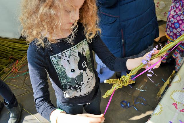 Molly decorating a wicker sword.
