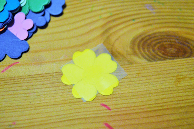 Paper flower with a glu dot on the back.
