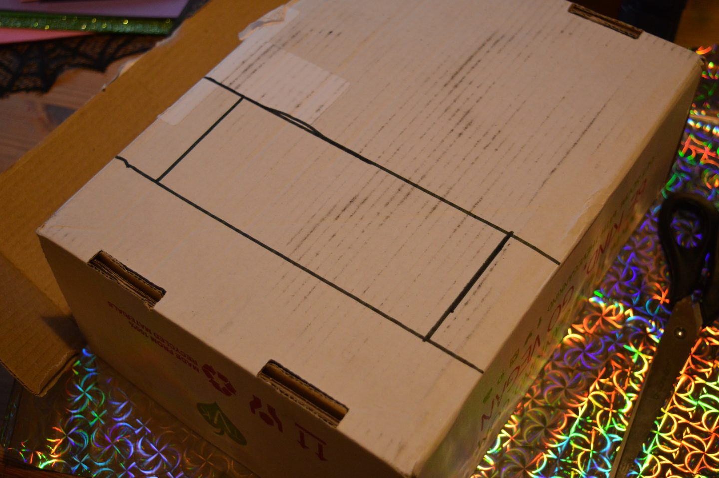 Make a Sweetie Robot Craft cardboard box with mouth area drawn in a black outline