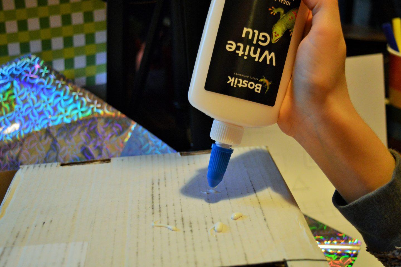 Make a Sweetie Robot Craft child using Bostik White Glu to stick paper to box