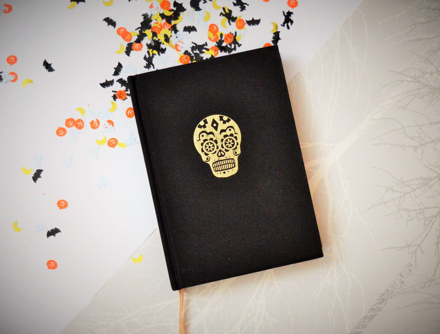 must have Halloween items for 2018 notebook with skull on the front