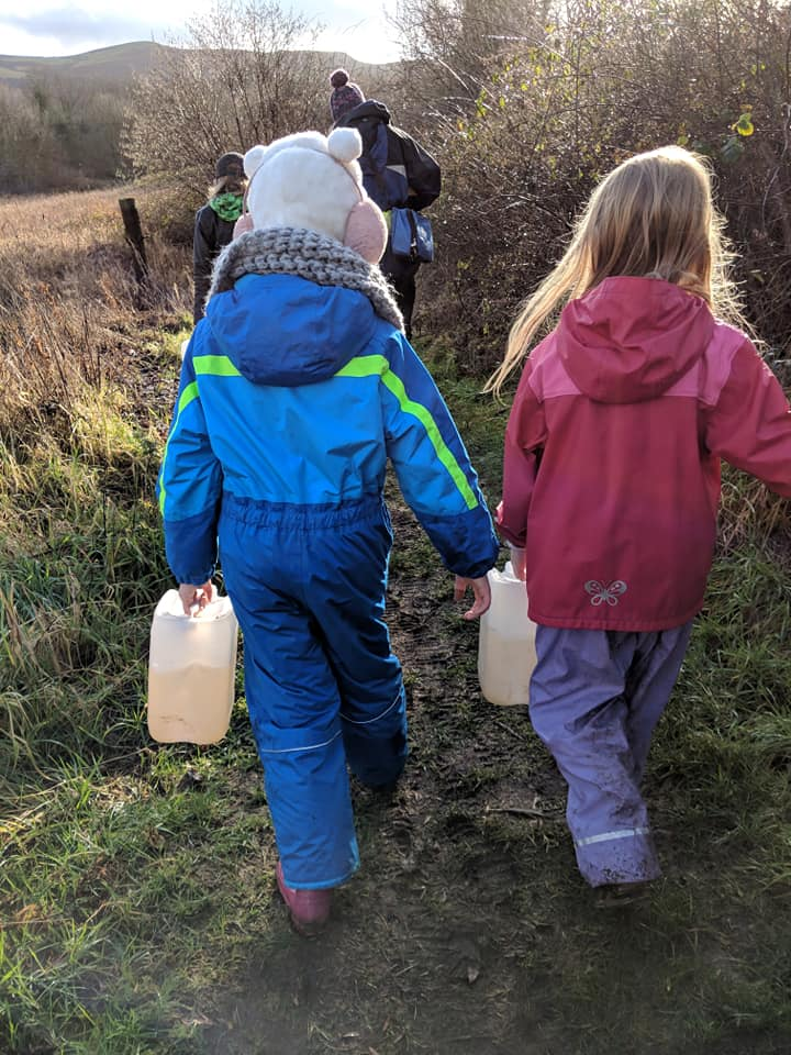 Welsh Water Reservoir two children carrying water from the river